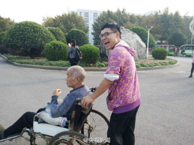 guy takes paralyzed father to university