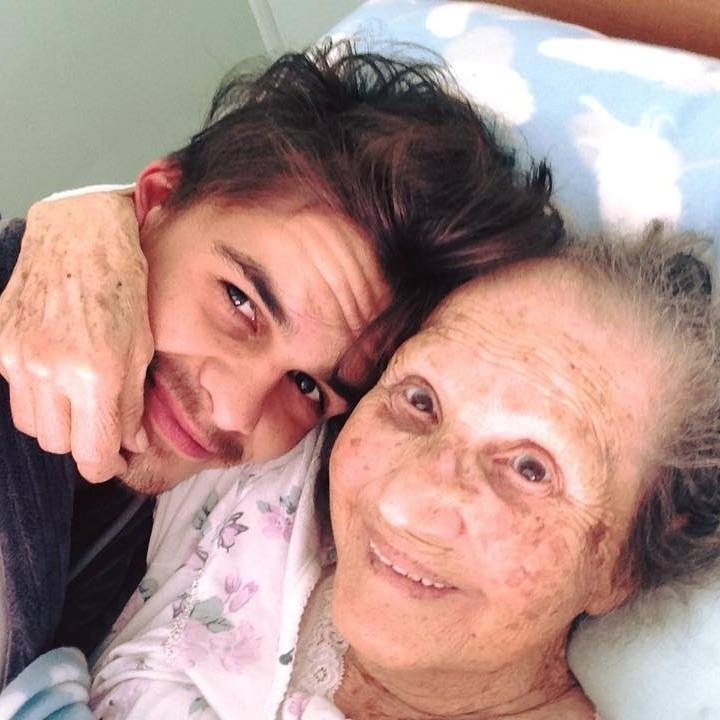 man taking care of sick grandma