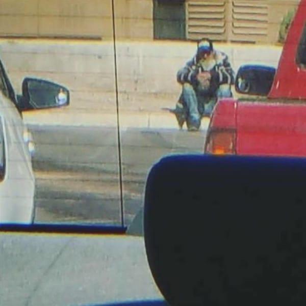 woman helps homeless man