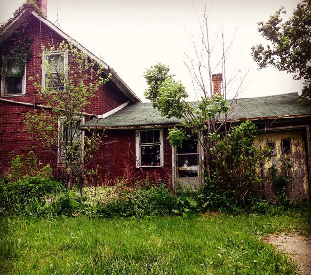 woman explores abandoned house