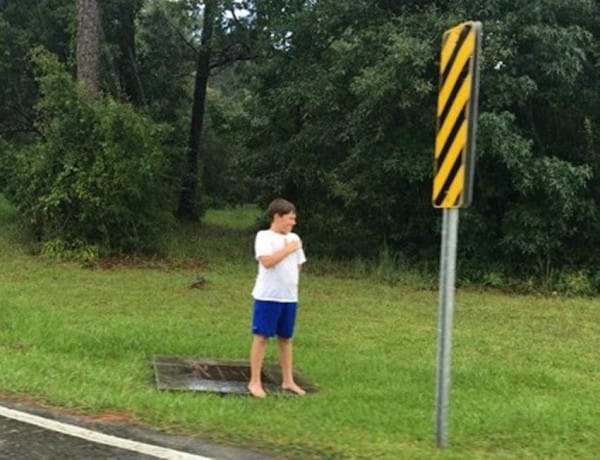 little-boy-waits-in-rain-4
