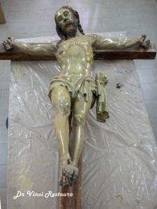 letter in butt of jesus statue