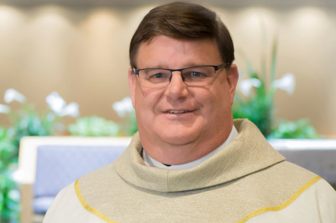 priest comes out as gay