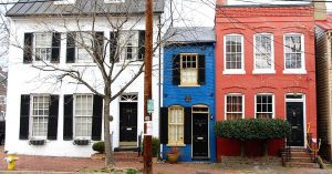 narrow alley blue house