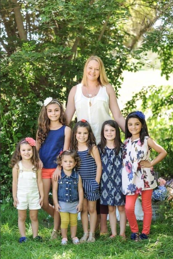 single mom adopts 6 sisters