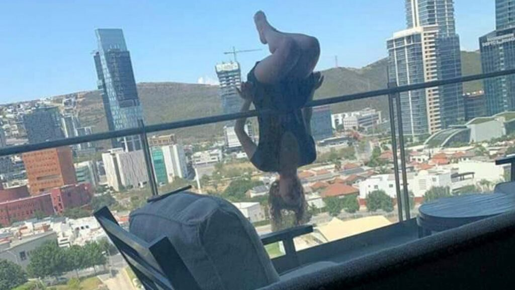 woman falls balcony yoga